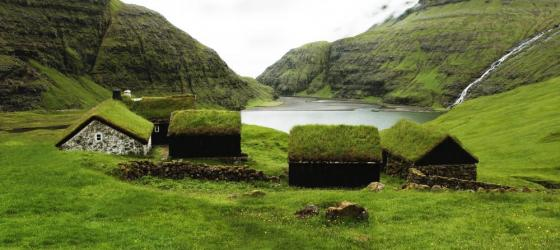 Grass covers the houses of the Faroe Islands, blending them into the landscape.