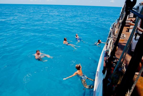 Swimming off the side of the Liberty Clipper in the crystal clear waters.