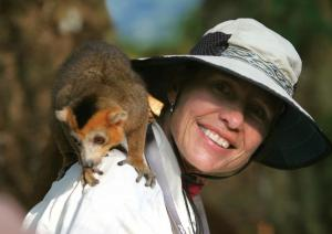 A traveler get up close and personal with a crowned lemur.