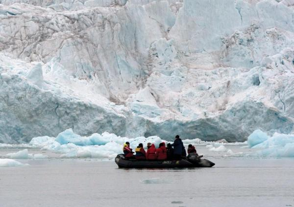 Take to a zodiac to explore massive ice formations up close