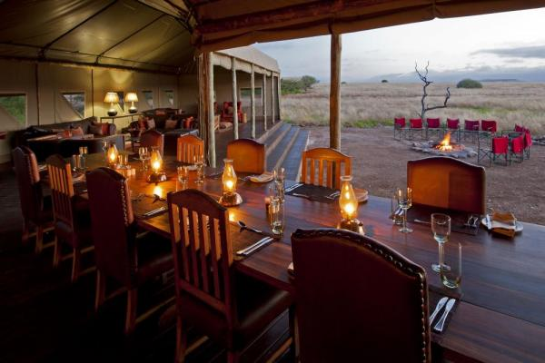 Enjoy a delicious meal while watching the sun set over the beautiful landscape.