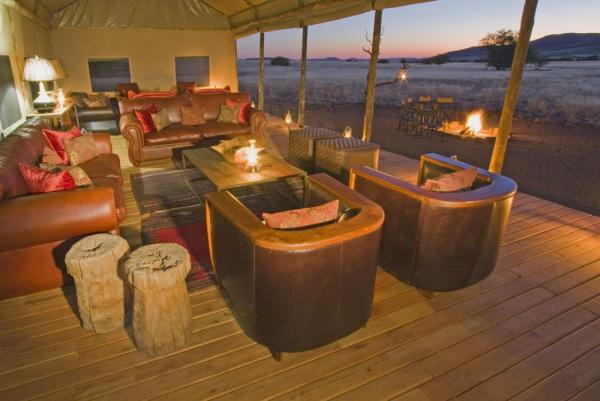 Enjoy the view at sunset from the Desert Rhino Camp's lounge area.