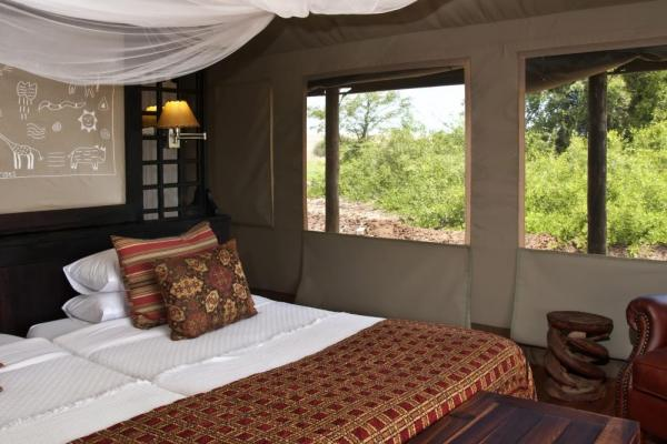 Relax in these comfortable and unique rooms at the Desert Rhino Camp
