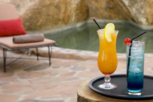 Relax by the pool and enjoy a drink at Camp Kipwe