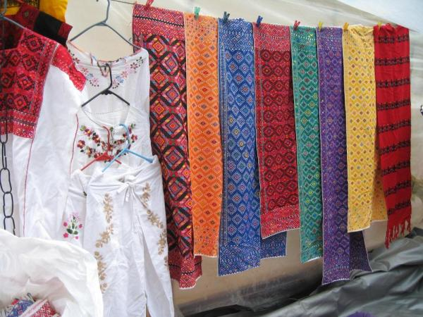 Enjoy markets filled with beautiful textiles.