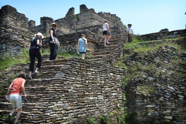 Travelers climb to the top of the Tonina ruins.