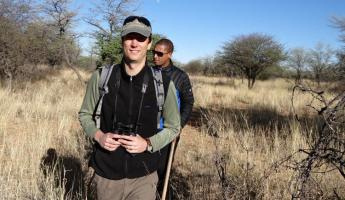 Travelers taking a hike through the African landscape