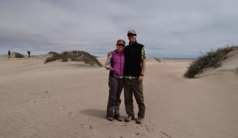 A couple pose on the desert sands of Namibia