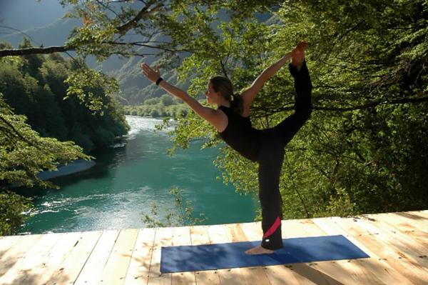 Enjoy some refreshing yoga by the river.