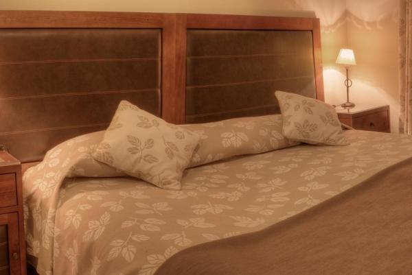 A cozy bed awaits at the Hotel Casa Don Tomas