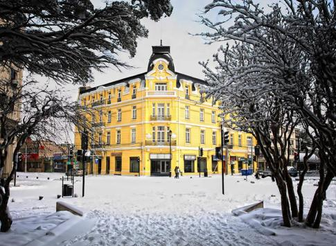The hotel surrounded in beautiful white snow