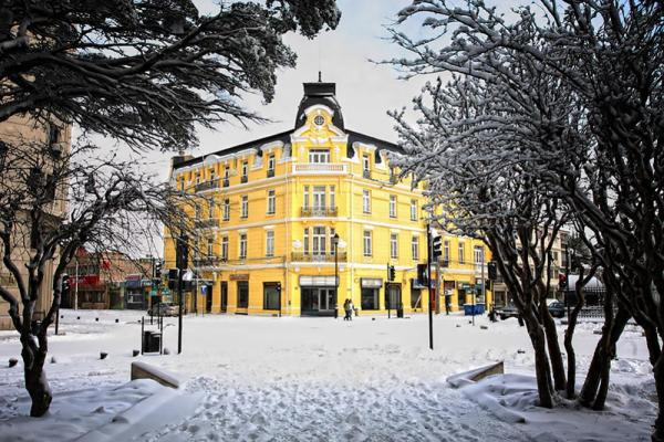 The Hotel Surrounded In Beautiful White Snow Plaza Punta Arenas