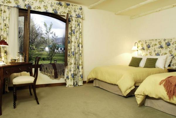 Spacious rooms that open into the grounds