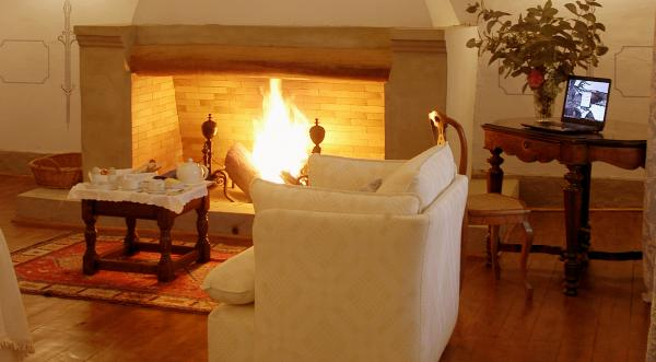 Stay warm by the fire in the cozy living space