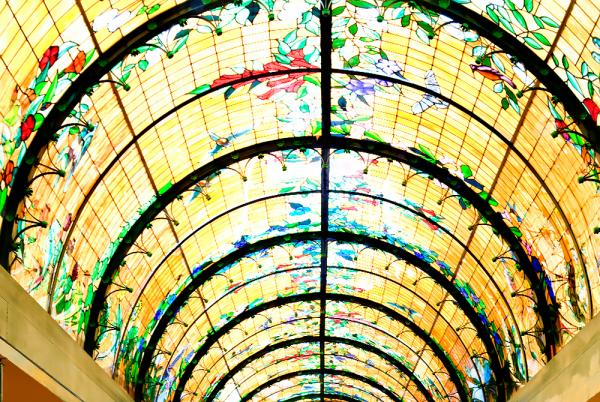 A beautiful stained glass ceiling covers the dining room