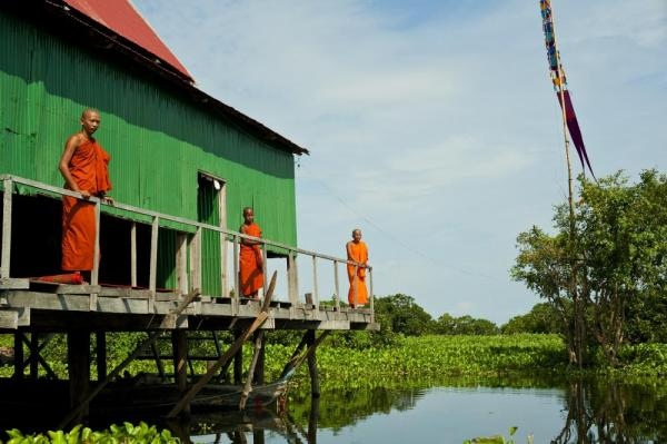 Monks above the water in Tonle Sap