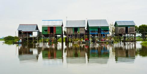 Explore the floating village of Tonle Sap