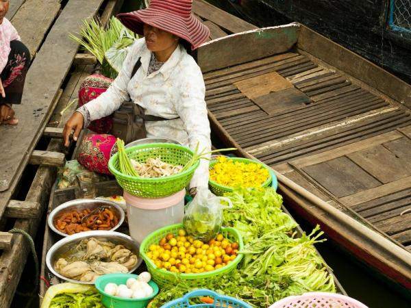 A local sells produce in the floating market