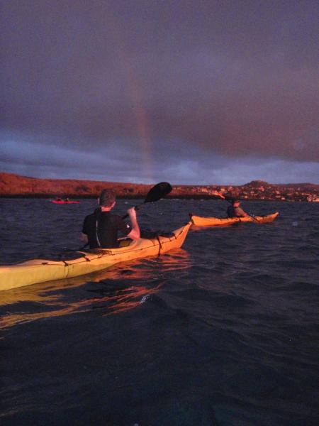 rainbow kayaking at sunset