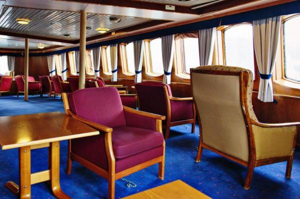 Enjoy the large windows as you sail on the MS Lofoten