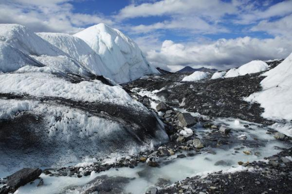 Glacier streams wind across the Alaskan landscape
