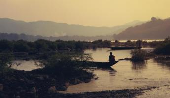 A local fisherman in the shallows of Burma