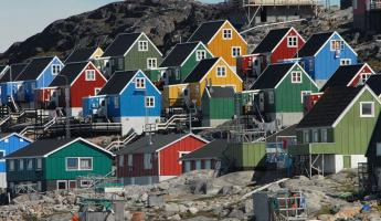 Remote villages along Greenland's coast bring color to the Arctic