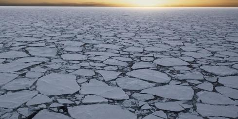 Watch the sun set over the iceber-filled Arctic Ocean.