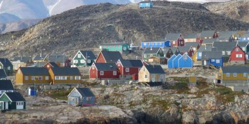 Observe the picturesque houses of Greenland