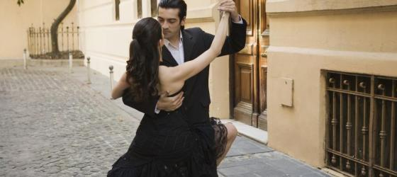 A young couple dances a traditional tango in the streets of Buenos Aires