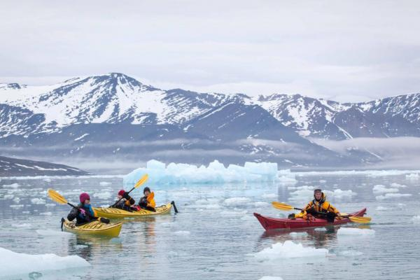 Kayakers come into close contact with icebergs