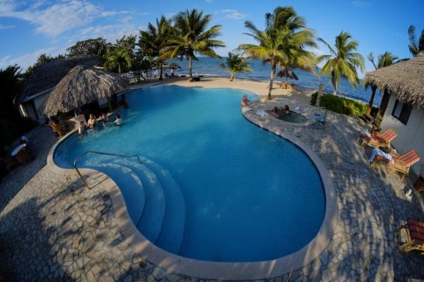 Swim in the pool at Almond Beach Resort & Spa