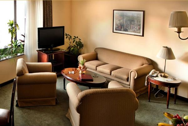 Comfortable seating area in your Grand Deluxe room at Ritz Apart