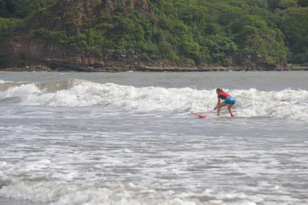 A new surfer catches a wave off the coast of Nicaragua