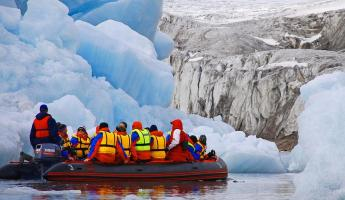 Cruise by zodiac to get up close and personal with Arctic icebergs