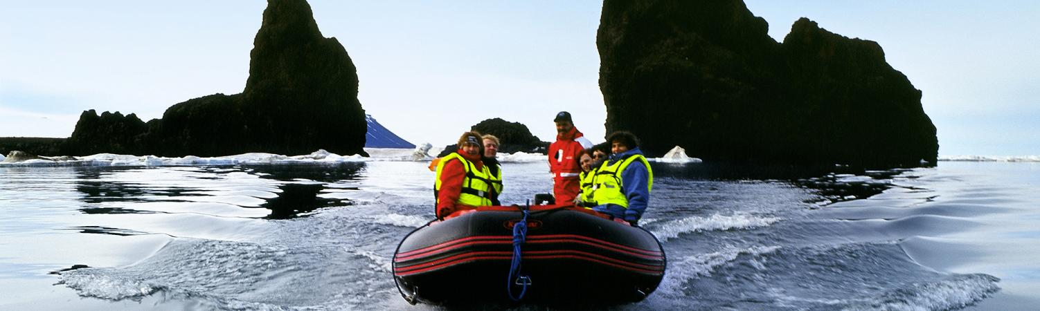 Zodiac boats bring you closer to the majestic Arctic landscape