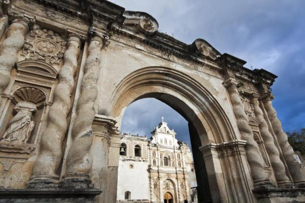 Antigua's cathedral as seen through stone arches