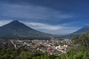 The city of Antigua is nestled between two volcanos