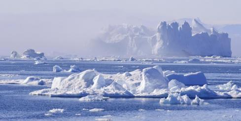 A towering iceberg drifts in Disko Bay