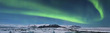 Northern lights dance across the Arctic landscape