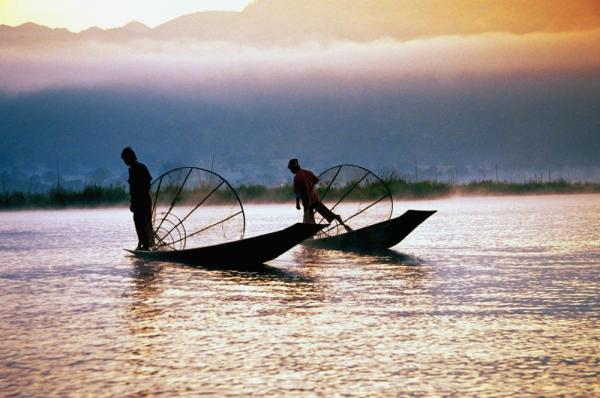Fishermen of Myanmar at sunset
