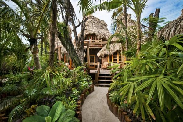 Walk the pathways at Ramon's Village's to your cabana