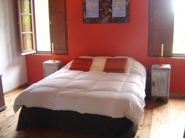 A comfortable room at Posada La Vigna