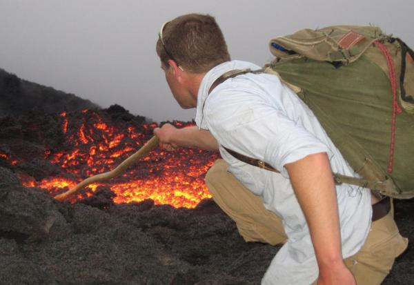 Joe plays with the lava of Pacaya Volcano