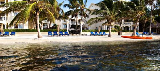 Relax on the large, sunny beach at Pelican Reef Villas