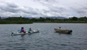 Kayak the still waters of Lake Atitlan on your Guatemala tour
