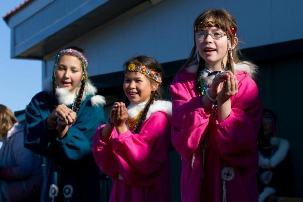 Local girls perform a song for visitors