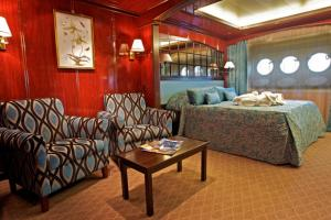 Your suite on the Caledonian Sky features three portholes