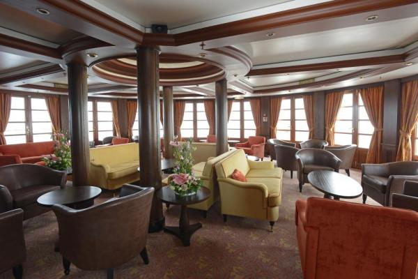 Relax in the lounge on the Caledonian Sky