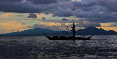 A lone fisherman off the coast of the Philippines
